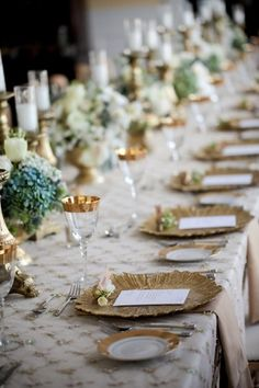 insane awesome. gold glittered leaf chargers with menu and place cards attached to a mini posy andlush restrained elegance of florals, candlesticks, gold white scheme.