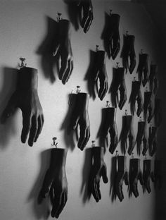 Wall of Male Mannequin Hands, black & white vintage photo, by Jason Langer.