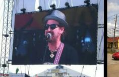 Jake Eckert of The New Orleans Suspects on the big screen at The 2013 New Orleans Jazz Festival.