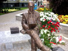 Man on a bench - Marian Rejewski Monument;  sculpture in Bydgoszcz, Poland;   Marian Rejewski was a Polish mathematician and cryptologist who in 1932 solved the plugboard-equipped Enigma machine, the main cipher device used by Germany.