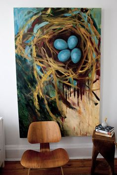 It's the chair that's said to be the focus.  However, I love the robin's eggs/nest painting in the background more.