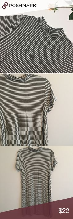 Grey and white striped hi-neck t shirt dress Super soft and flowy high neck tshirt dress. Great and white striped. Never been worn or washed! Feel free to ask questions or make an offer! Dresses Mini