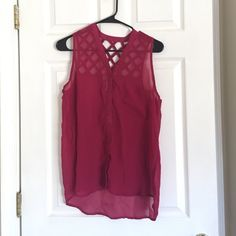 Sleeveless shirt with crossed back Light transparent shirt with awesome back detail. Worn a handful of times, very comfy. PacSun Tops Tank Tops