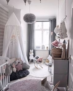 Love this beautiful kid's room! Vita Eos light shade, Miffy lamp, Cam Cam Rainbow mobile are all available at www.istome.co.uk