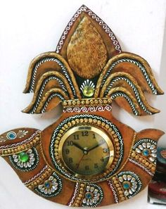 Beautiful handmade Kalash Shehnai shaped wall hanging #clock. It is wooden base crafted with kundan  meena and Clay Work. This item can be used as #homedecor item and can be gifted to your near and dear ones.