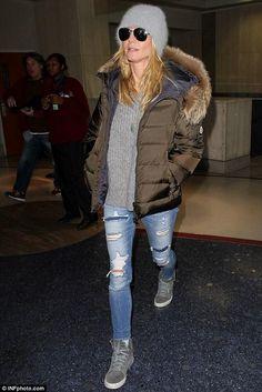 Heidi Klum wearing Paper Denim & Cloth Flx Ankle Skinny Jeans in Chalk Destructed, Moncler Down Jacket and Rag & Bone Kent High Top Sneakers in Light Grey