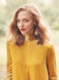 Amanda Seyfried wears her golden locks in a wavy lob hairstyle for Allure Magazine November 2016