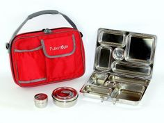 PlanetBox Rover Lunchbox - Red Carry Bag with Rocket Magnets by PlanetBox. $59.95. All in one piece design for easy care and cleaning - no mismatched lids to lose - dishwasher safe.. Includes stainless steel lunchbox, 2 round lidded containers; a soft carry bag, and set of hip magnets. Individual compartments ensure foods don't touch each other and arrive looking neat and appealing. Made out of safe, non-toxic, and recycled materials - no lead, PVC, phthalates, or BPA. C...