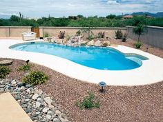 small swimming pool with xeriscape... I can dream
