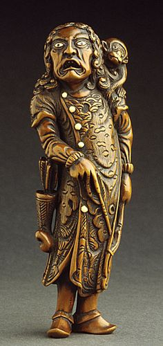 Ryusai (Japan)   Foreign Archer with Monkey, late 18th century  Netsuke, Wood with inlays,