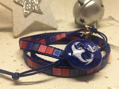 This triple wrap style bracelet features tile shaped beads in red and blue, with matte and iridescent finishes, attached to navy blue leather cord. A handmade ceramic button decorated with an anchor has been used for a fastener. Two little silver plate. Triple Wrap, Feature Tiles, Wrap Bracelets, Organza Gift Bags, Leather Cord, Fashion Bracelets, Wrap Style, Red And Blue, Silver
