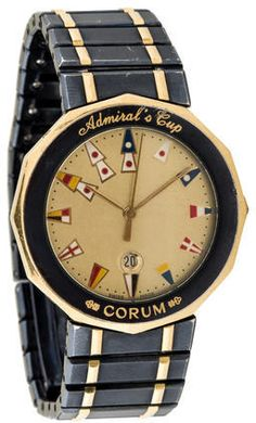 Men's 18K yellow gold and blue stainless steel 34mm Corum Admiral's Cup quartz watch with engraved bezel, gold-tone flat dial, international flags index hour markers, gold-tone sword hands, push/pull crown, 18K yellow gold and stainless steel link bracelet and double deployant clasp closure.