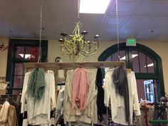 Using a vintage ladder as a clothing display! #studio1220pointloma #studio1220 #sandiegoboutique #chandelier