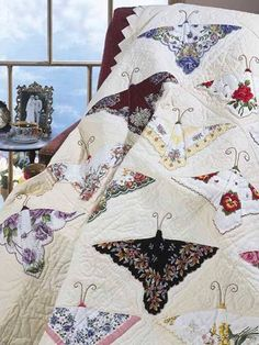 Butterfly hankie quilt. Butterflies made from vintage hankies. If you have vintage hankies this would be a good way to use them.