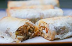 Baked Phyllo Spring Rolls use sheets of light phyllo dough to roll up lots of fresh veggies and meat to make crisp, delicious spring rolls.