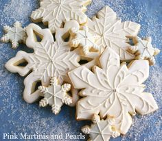A flurry of wintry snowflake cookie ideas! DIY tutorial and recipes for Decorated Snowflake Cookies!