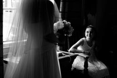 WPJA 2010 Q3 Contest - GREAT NATURAL LIGHT - 4th Place - Photo By: Ryan Browne from South Yorkshire, England  Judges Comments:  Window lighting adds to a sweet moment of a little girl as she looks up admiringly at the bride. The photo is framed beautifully with the veil and flowers catching side light of the bride focusing on the little girl. Black and white adds to the simplicity of the image.  More photos/info at http://www.WPJA.com/