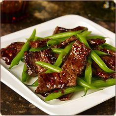 Sweet & Spicy Beef – 2 tablespoons low sodium soy sauce, 2 teaspoons corn starch, 12 oz flank steak thinly sliced against the grain, ½ tablespoon peanut or vegetable oil, 8 scallions, greens and whites separated and chopped, 4 gloves garlic thinly sliced, 2 cups mushrooms sliced, 4 cups green beans ends removed or sugar snap peas, 2 tablespoons hoisin sauce, 1 tablespoons chili garlic sauce.  1.  In a large shallow dish, stir together the soy sauce and cornstarch with a fork. Add the steak…