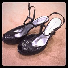 """Peep toe straps sandals Black perforated t-strap peep toe sandals, perfect with your little black dress or and cocktail dress for the holidays! 2 1/2"""" heel with 1/2"""" platform. Gently used. Anne Klein Shoes Sandals"""