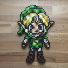 Legend of Zelda / Link Perler Bead Sprite by BeardedArtists Melty Bead Patterns, Pearler Bead Patterns, Perler Patterns, Beading Patterns, Perler Beads, Perler Bead Art, Fuse Beads, Perler Bead Designs, Perler Bead Templates