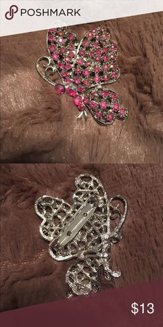 """NWOT Stunning Butterfly Brooch This is a NWOT absolutely stunning butterfly brooch.  This brooch has never been worn and is adorned with bright pink rhinestones.  It measures approximately 2 1/2"""" from top to bottom. Jewelry Brooches"""
