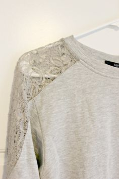 I rather like the comfortable casual of this sweatshirt/sweater with the lace detail in the shoulders. A little dressier than just a sweatshirt. But its the neutral/oatmeal color that I like the most. (SB)