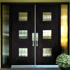 Contemporary Double Door with Glass & Sidelites            This custom door revels in mid-century retro style.  The geometric glass design and black finish combine create a stunning contemporary effect.: