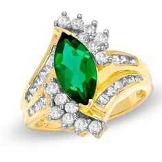 The marquise-shaped lab-created emerald center stone is made more magnificent by swirling ribbons of princess-cut & round lab-created white sapphires.