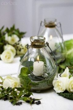 lanterns make pretty centerpieces - would love to do in our little candle holders!