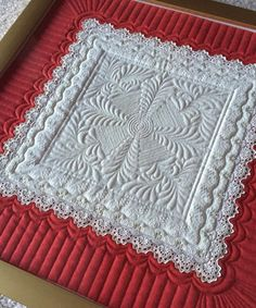 Kelly Cline Quilting - framed a quilted vintage handkerchief.