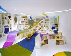 Book Store by Sako Architects // Sako Architects designed this wonderful book store for children, in Bejing, China. The coloured ribbon flows through the building to cultivate children's curiosity. The rooms are designed around activities like story telling and theatre. // www.lookslikegooddesign.com/book-store-by-sako-architects/