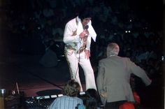 Father and Son....June 25 1977, The Riverfront Coliseum, Cincinnati OH wearing The Mexican Sundial Suit & original belt. Attendance : 16,795 | Elvis Wearing NO Rings