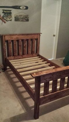 """DIY Twin Bed from construction lumber: """"RustyHacksaw"""" gives details of how he did it and how he created it to eventually be turned into a bunk bed! The finish is Red Mahogony Varathane with Varathane Polyurethane coating over. With this stain there are lots of options you can see here: http://www.rustoleum.com/product-catalog/consumer-brands/varathane/premium-wood-stains/"""