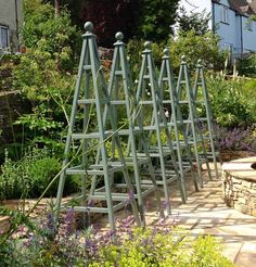 Best landscape design is under construction Landscape Design, Garden Design, Obelisks, Cool Landscapes, Under Construction, Design Ideas, Outdoor Structures, Plants, Landscape Designs