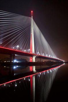 The Ada bridge or alternatively Sava bridge is a cable-stayed bridge over the Sava river in Belgrade, Serbia. The bridge crosses the tip of Ada Ciganlija island, connecting the municipalities of Čukarica and New Belgrade.