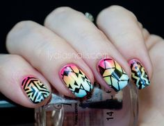 These rainbow ombre nails with the geometric patterns on them are some of my favorite! Get custom Jamberry nails like these by contacting me at facebook.com/glamjamsquad!