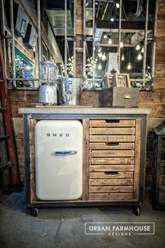 Leave it to to create the ultimate The rugged, casual look of the concrete top pairs perfectly with the custom-built reclaimed wood base. The Mini-Fridge will make this hard-working cart the center of every gathering. Smeg Mini Fridge, Retro Fridge, Industrial House, Vintage Industrial, Fridge Built In, Urban Farmhouse Designs, Game Room Bar, Vintage Bar Carts, Fresh Farmhouse