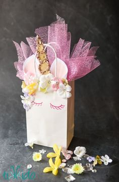Transform a plain white gift bag into a magical, unicorn themed gift bag with this easy tutorial.