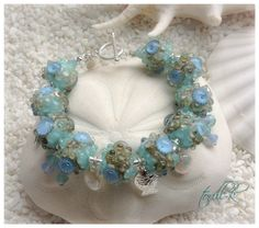 Handmade bracelet by torill-k with beautiful lampwork from Clare Scott, swarovski-crystals and Sterling silver