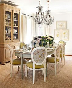 The chandeliers and bakery cupboard in the dining room are 19th-century French. Custom linen draperies and the Swedish-style dining table are from Vintage Living/Lisa Luby Ryan. Chair fabric is by Cowtan & Tout through Culp Associates.