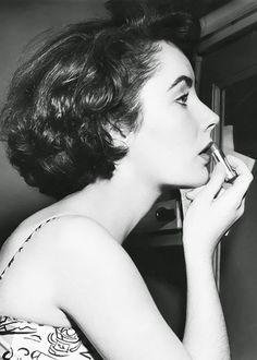 Makeup checkup – Elizabeth Taylor putting on lipstick.
