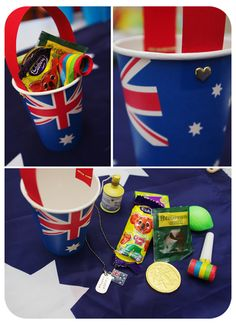 Australia Day loot. Great party favour idea for the kids. Bucket made with paper party cups, strips of red card and brads (paper fasteners). Filled with Aussie themed loot - Caramello Koala, Aussie coin, Beechworth honey, Australian sultanas, Aussie flag dog tag necklace, party blower. #CelebrateAustraliaDay