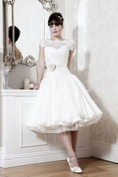 Tea-length Wedding Dress. I'm a traditional girl so floor length+, but maybe this as a reception or rehearsal dress...
