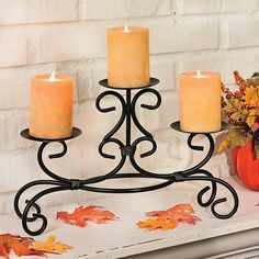 "Three Pillar Candleholder - TerrysVillage.com - curved metal details and different candle elevations - 10 1/2""W x 16""H"