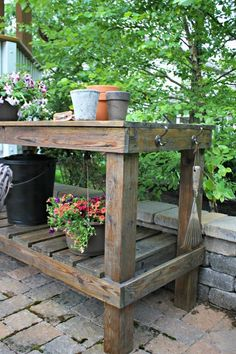 How to bring an old potting bench back to life at Thrifty Decor Chick! pallet garden table potting benches Refinishing our outdoor potting bench Outdoor Potting Bench, Potting Bench Plans, Potting Tables, Potting Sheds, Rustic Potting Benches, Potting Bench With Sink, Outdoor Storage, Diy Garden Table, Diy Garden Decor