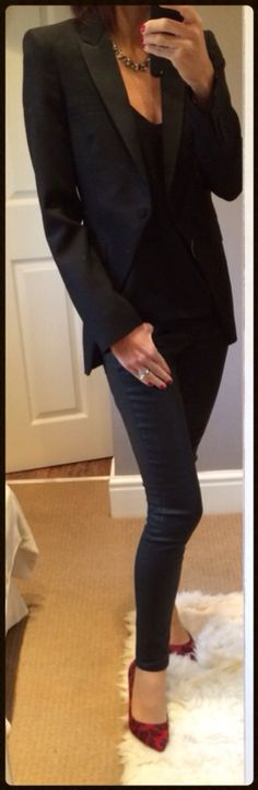 Tuxedo style morning coat with black wax effect jeans & red leopard print court shoes