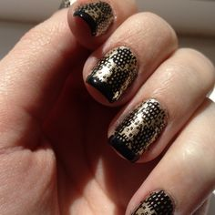 I found a gold polish at Walgreens this morning and was excited to try it. I've wanted to do gold and black nails for weeks but couldn't find a gold I liked.