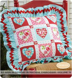 "Happy Hearts Pillow - by Jo Connolly ""Happy Hearts Pillow uses charming retro-vibe red & aqua fabric prints. The embroidery files are free for this project!""  #sewing #quilting #embroidery #ValentinesDIY"