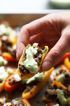 """Ditch the chips for a healthier nacho and use mini bell peppers! These Fajita """"Nachos"""" are cute, delicious, and healthy. They're made with mini bell peppers, lean ground beef, and avocado crema."""