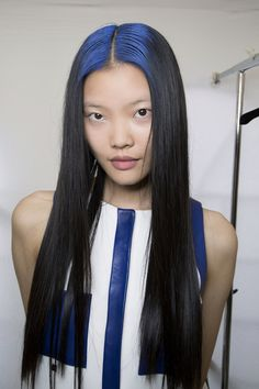 We're obsessed with the rainbow roots from the Maxime Simoëns Spring 2015 runway. Blue, pink, yellow — whatever hue you choose, this is an awesome, unexpected way to cover roots and play with color. Image: Imaxtree